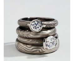 George Sawyer's 14k white gold and sterlign silver Mokume Gane engagement and wedding bands