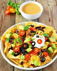 Another family recipe that is so easy to prepare, delicious black beans, tortilla chips, avocado, olives, tomatoes, smothered in creamy cashew sauce!