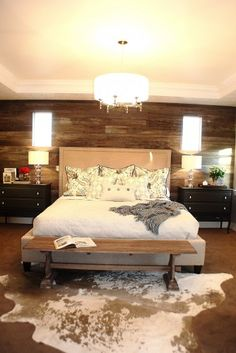 Rustic elegant bedroom with barn wood wall by Judith Balis Love these barn walls & contemporary mix w/ animal print rug.