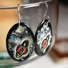 RInged Planet and Space Ceramic Earrings in Black and by surly, $22.00
