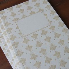Blank book with letterpress printed cover featuring gold bees on pale gray Fabriano paper. Includes 40 blank pages. Lovingly printed and perfect bo...