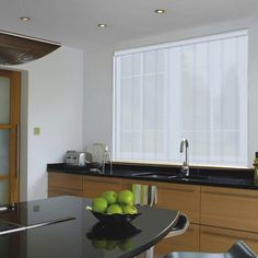 A sheer patterned roller blind in a grey colour
