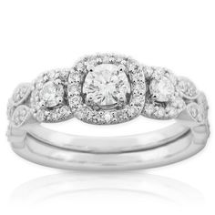 Diamond engagement ring and matching wedding band, in 14K white gold. Center diamond is 1/3 carat, side diamonds total 1/2 carat. #Engagement #Ring #Halo