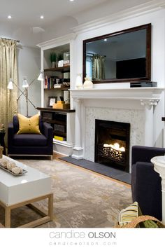 Interior Design Ideas for Fireplace Room • White Fireplace • Built In Bookshelves • Classic Fireplace Design with Columns • Recessed Lighting Placement on Fireplace Wall • Floral Rug • Room designed with Gray and Gold Palette • #candiceolson #candiceolsondesign Fireplace Tv Wall, White Fireplace, Cozy Fireplace, Fireplace Design, Classic Fireplace, Candice Olson, Gold Palette, Bookshelves Built In, Elements Of Design