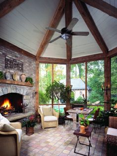 Country French home's Screened Porch. The Cabana is visible beyond...