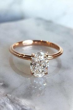 25 Gorgeous Engagement Rings To Get You Inspired: a rose gold engagement ring with an oval diamond solitaire is another classic idea to try Wedding Rings Solitaire, Wedding Rings Rose Gold, Beautiful Engagement Rings, Wedding Rings Vintage, Rose Gold Engagement Ring, Vintage Engagement Rings, Bridal Rings, Unique Solitaire Engagement Ring, Engagement Bands