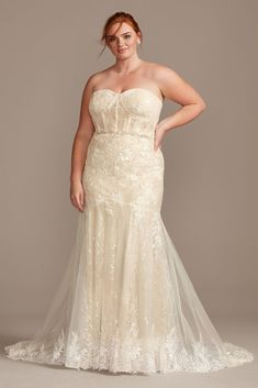 Embellished with embroidered appliques and sequins, this lace wedding dress exudes sultry sophistication. The strapless, lingerie-inspired corset bodice has bustier-style cups and grosgrain-covered bo Plus Wedding Dresses, Elegant Wedding Gowns, Davids Bridal Dresses, Wedding Dress Trends, Wedding Dress Sleeves, Perfect Wedding Dress, Wedding Dress Styles, Bridal Gowns, Lace Wedding