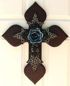 Brown/Blue stacked wooden cross with black iron cross and blue metal rose.  $85.00