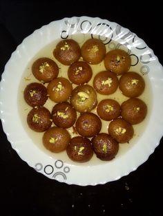 Indian sweet gulab jamun in saffron dip sugar syrup