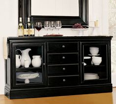 Love The All Black Sideboard With White Items Behind Glass Doors Buffet