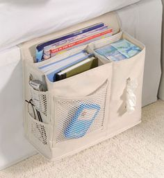 Keep your nightly essentials right on hand with this Bedside Storage Caddy available in natural denier. This organizer holds reading material and more.