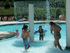 The Stone Creek Pool and Lazy River has something for everyone- playing under the mushroom fountains