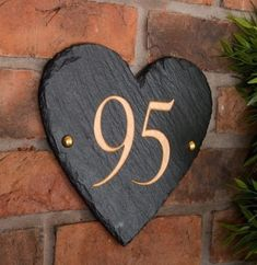 A beautiful handmade house number High quality, charcoal grey, rustic slate  Hand riven, hand engraved and hand painted by our experienced artisan craftsman  Size 24 x 22cm  Fittings provided  Hand painted in gold Finished with a protective layer of wax for a hard wearing, long lasting, and Good Slate House Numbers, Georgian Homes, Charcoal Color, Handmade Home, Hand Engraving, Craftsman Style, Heart Shapes, Wales Uk, North Wales