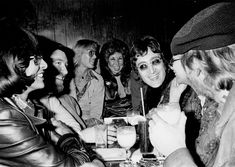 John Lennon attends a Smothers Brothers comedy performance with girlfriend May Pang, Peter Lawford, Jack Haley Jr. and singer-songwriter Harry Nilsson, during Lennon's infamous 'Lost Weekend' period, at the Troubadour on March 12, 1974, in West Hollywood, California. Lennon and Nilsson would later be kicked out of the show for drunken heckling. Michael Ochs Archive/Getty