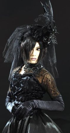 Exceptional head piece on this Neo-Victorian Mourning Goth girl. I scored an awesome dress around halloween and this is exactly the direction i wanna take it in... A less modern hairstyle though
