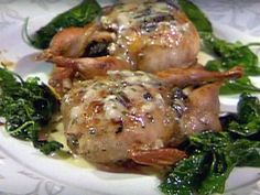 Mushroom-Stuffed Quail Ingredients: 8 (3 1/2 ounce) boned quail 2 tablespoons Creole seasoning Mushroom Stuffing (recipe follows) 4 tablespoons melted butter Truffle Sauce (recipe...