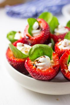 These Goat Cheese & Spinach Stuffed Strawberries with Candied Walnuts & Balsamic Glaze are the perfect bite!