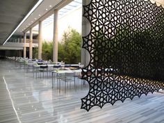 This modular system is built around the shape of a hexagon in a variety of designs and colours, which can be freely combined to create a hanging screen. The product is made from moulded fibre felt and has an inspiring pattern. It is fixed to a straight or angled aluminium rail for mounting in the ceiling or on the wall.