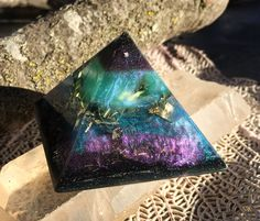 Smokey Quartz and citrine power up this Shungite orgonite pyamid. Orgone is another word for the subtle, yet powerful energy of creation.