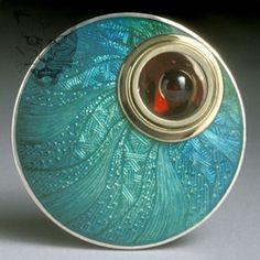 Piece item                   f  Brooch    Round silver and enamel garnet brooch.    £820                               Dimensions:         40mm                             Photographer:        FXP Photography