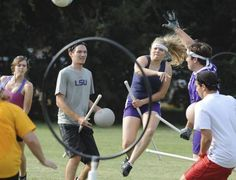 Melissa White scores as Kody LaBauve with bludger, watches during an LSU quidditch team practice game
