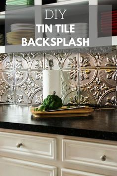 Create a Stylish Backsplash Using Tin Tiles >> http://www.diynetwork.com/how-to/rooms-and-spaces/kitchen/how-to-install-a-tin-tile-backsplash?soc=pinterest