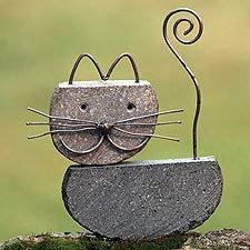 Cute yard art made of rock and wire