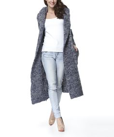 Simply Couture Blue Chunky-Knit Wool-Blend Open Duster | zulily . $29.99 Compare at $139.00  size: size chart.  S . M . L . XL . : Product Description:  Wool blend fabric makes this trendy layer a toasty choice. A soft hood tops off your look with an extra layer of warmth.      45% wool / 40% polyester / 15% acrylic  .     Hand wash  .     Imported