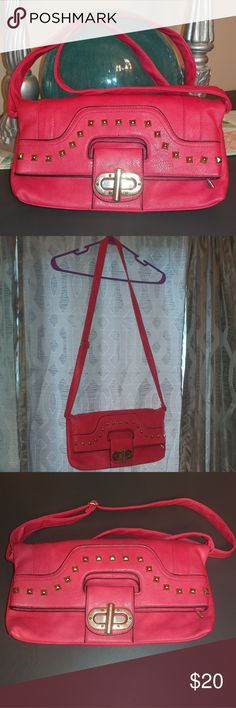 "NWOT Hot Pink Crossbody with gold studs NWOT Pink crossbody with gold studs.   Beautiful hot pink faux leather crossbody purse with adjustable strap and zip closure.   The purse itself folds over and the gold bar is moved left to right to open or close.   The inside features one zip compartment on one side and the other has 2 open compartments for your cell phone or what have you.  14"" Wide 7.5"" - 8"" High (while closed) 13"" High (when open) Bags Crossbody Bags"