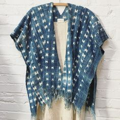 this short designed kimono represents a lighter shade of blue, with white crosses.