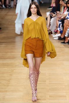 golden yellow bell-poet sleeve blouse and gladiator sandals at Chloé S/S 15. If you're older, exchange the shorts for a long, flowing skirt. (keep for article)