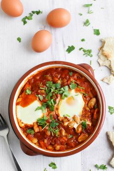Cannellini bean shakshuka (eggs baked in a rich tomato sauce) - a ...