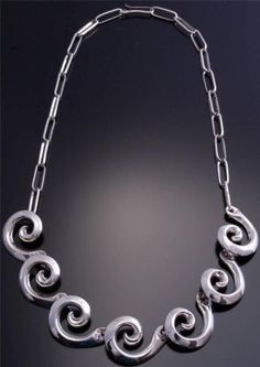 $288.75 - 16 inch Sandcast Silver Overlapping Spiral Necklace Navajo Handmade - This sandcast necklace is a traditional Navajo design that is sandcast out of sterling silver.  Seven beautiful silver spirals  hang from links that create this 16 inch choker style necklace.