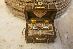 I love this little pirate chest wedding rings holder! Perfect for a Pirate Themed Wedding (much better than a ring pillow)
