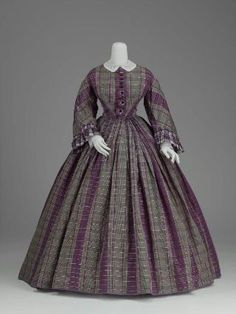 Lovely colors! This may have been a second mourning dress - lavender and gray were used as a transition from full mourning      Dress. c. 1859-60. American. Silk plain weave (taffeta) with warp and weft float patterning, fringed silk buttons.