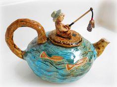 the Ocean Turquoise Blue Tea Pot set, Teapot set drawing fish decor. $80.00, via Etsy.