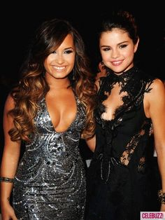 Demi Lovato and Selena Gomez at 2011 VMA's.