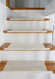 Learn how to install a rug runner on your staircase for under $120... it's easy! #How-To, #Curbly-Original, #DIY, #carpet, #Stairs, #inexpensive