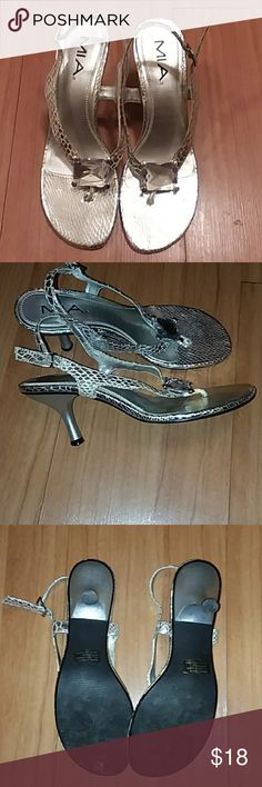 MIA Heeled Sandals EUC sparkly silver sandals! Worn only a few times. These are gorgeous! Some discoloration on the inside of the strap which is not visible when wearing. These are awesome otherwise! MIA Shoes Sandals