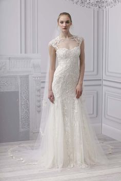 Monique Lhuillier - Radiance   (Platinum collection)  ivory   chantilly lace illusion cap sleeve sheath, with embroidered tulle overlay, low back, and godet skirt.