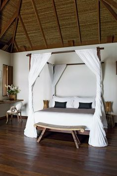 To furnish the rooms of Song Saa, the private island hotel in Cambodia that she part owns with her husband, Melita Hunter travelled widely through South-East Asia gathering ideas and commissioning craftsmen. This four-poster bed was commissioned in Cambodia, and copied from a design Melita had seen in Chaing Mai. It is hung with White Muslin from Thailand.