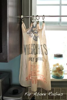 hang vintage feed sack with clips for a cute and fun curtain