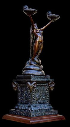Dimensions: 940 mm high x 330 mm x 360 mm Edition: Series of 15 The sculpture depicts a priestess of the Mysteries of Isis, round about the second century AD in Rome, performing a ritual to ensure fertility, regeneration and immortality of the soul. In ancient times man was not conditioned to see the snake …