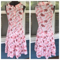"TAHARI Floral Summer Dress TAHARI Floral Summer Dress.   Peter Pan collar.   Sleeveless.  Button front to drop waist.   Pleated skirt.  Pink, white & marion cotton/spandex blend material.  Pit-to-pit 17-1/2"".  Length 39"" (shoulder to hem).  Excellent condition. Tahari Dresses Midi"