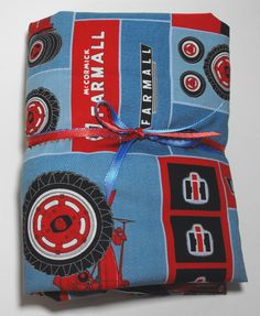Case IH Farmall Tractor Bedding Fitted Sheet for Crib or Toddler Bed With Matching Pillow Case by KidsSheets on Etsy https://www.etsy.com/listing/223633909/case-ih-farmall-tractor-bedding-fitted