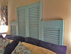 Repurposed Window Shutters into a headboard for a bedroom.