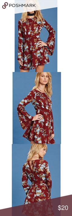 "NWT. Burgundy bell sleeves dress NWT. Burgundy long bell sleeves dress. A woven dress featuring a blue floral print, round neckline, self tie keyhole back, concealed back zipper, and a flared hem. About 34.5"" long. Chest: about 35"". Waist: 27.5"". Sleeve length: 24.5"". Sorry, no trades. Like the item but not the price, feel free to make me a reasonable offer using the offer button. Dresses Long Sleeve"