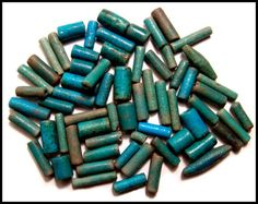 A handsome lot of faience tube beads, Late Period, c.664 - 30 BC, each of a turquoise to green-blue color and larger than the types normally encountered. Each with vivid colors and with lengths from 10mm to 25mm. Ex Irish collection.
