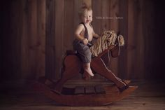 Love the dark wood tones and the rocking horse... not to mention the cutsie overalls!!