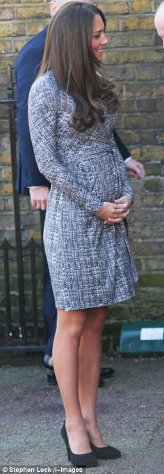 For Kate's return to public engagements this morning she chose a past season MaxMara Studio dress, opting to go coatless under London's sunny skies.